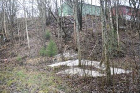 Slagghaugen ligger i en skråning ved det nedlagte gruveanlegget i Søve. Foto: NGI-rapport 20091927-00-14-R